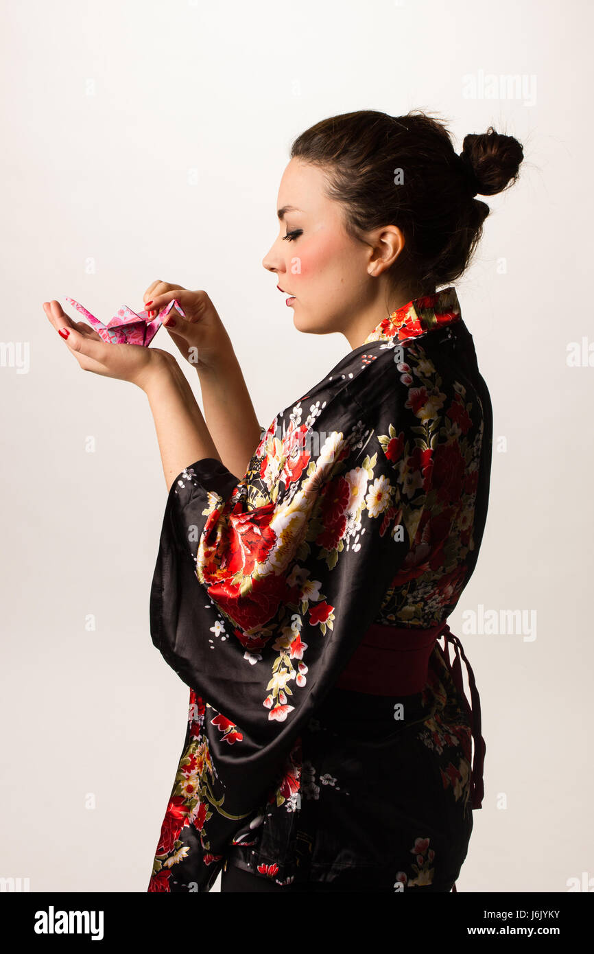 japanese kimono girl with origami - Stock Image