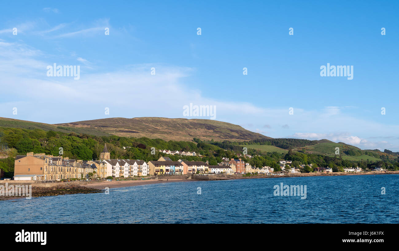 View of Fairlie Village and the bay with the hillside in the back and far distance. - Stock Image