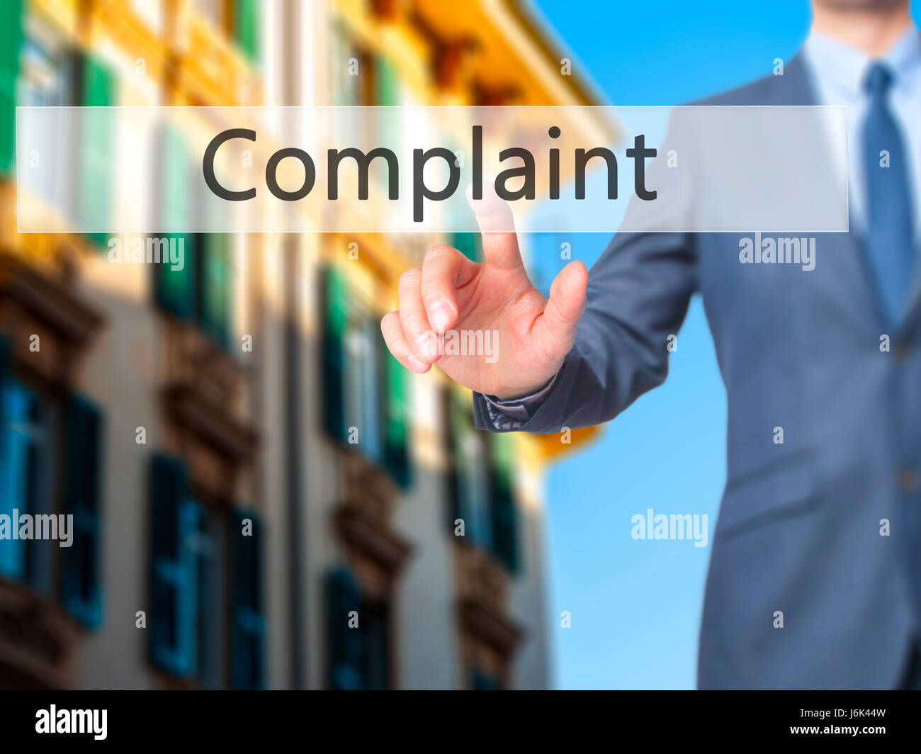 Complaint - Businessman click on virtual touchscreen. Business and IT concept. Stock Photo - Stock Image