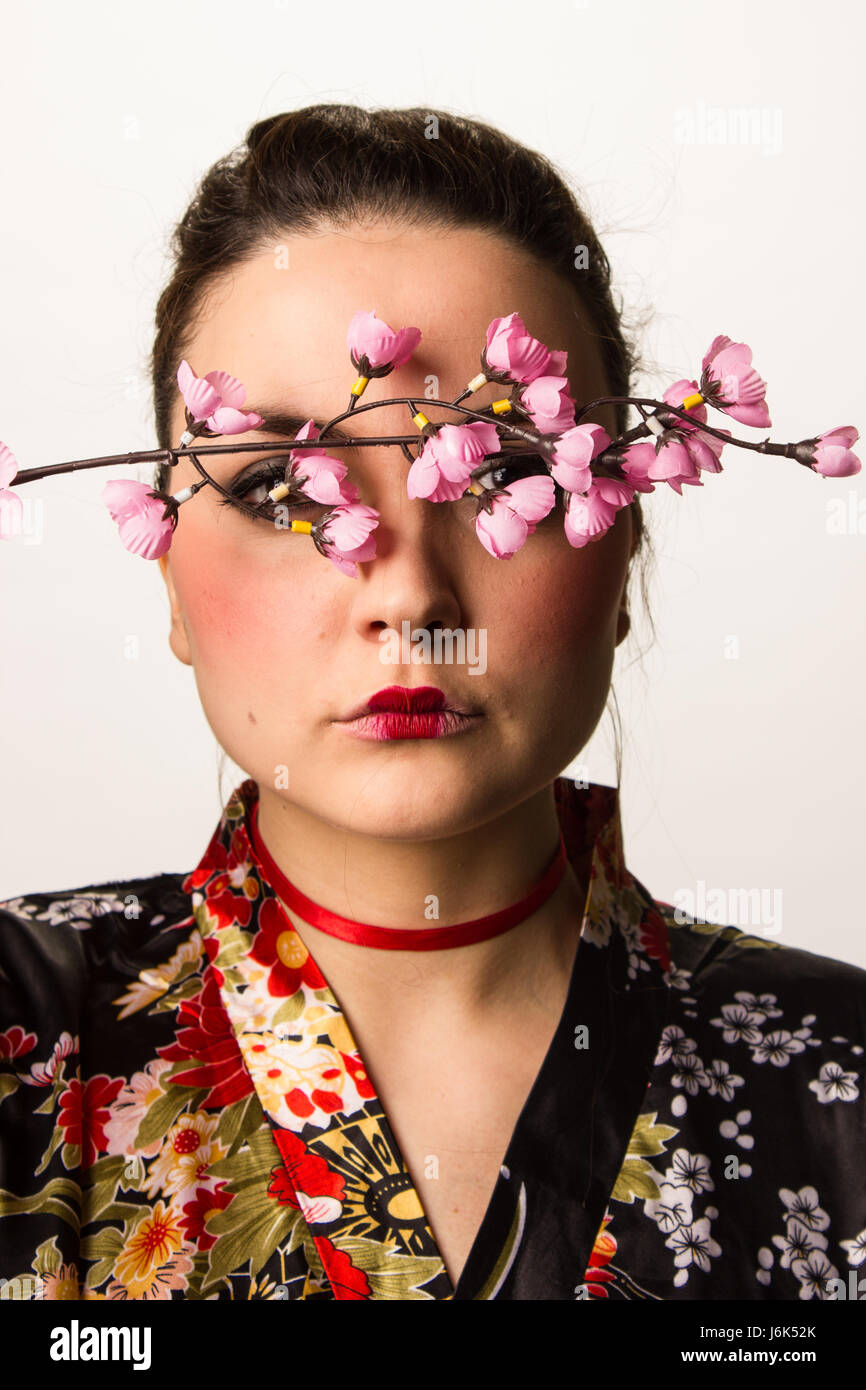 portrait of a girl with kimono and cherry blossom - Stock Image