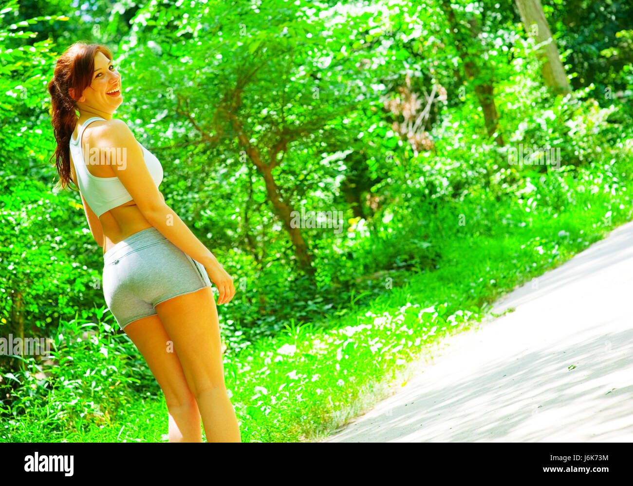 woman exercise strain stretching exercising girl girls forest fitness woman - Stock Image