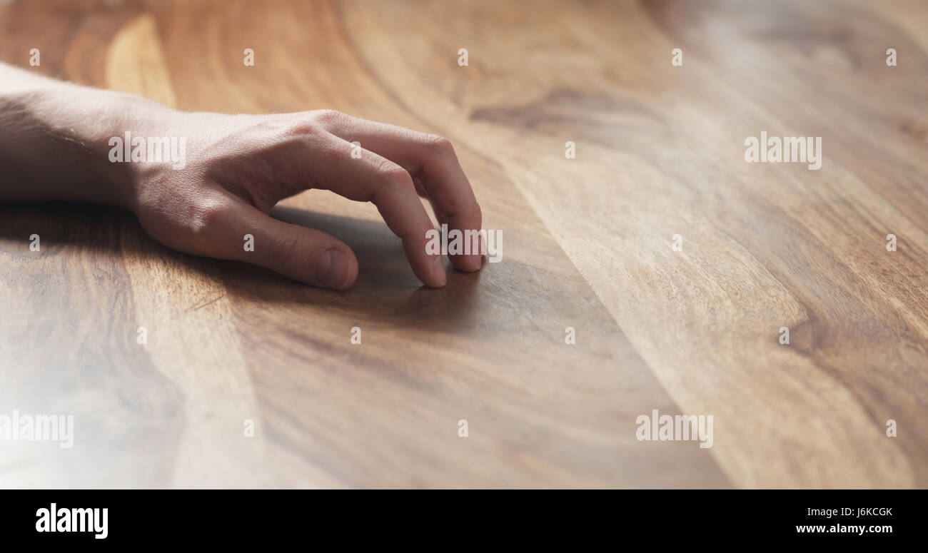Young man hand waiting tapping fingers sitting at the table, wide photo - Stock Image