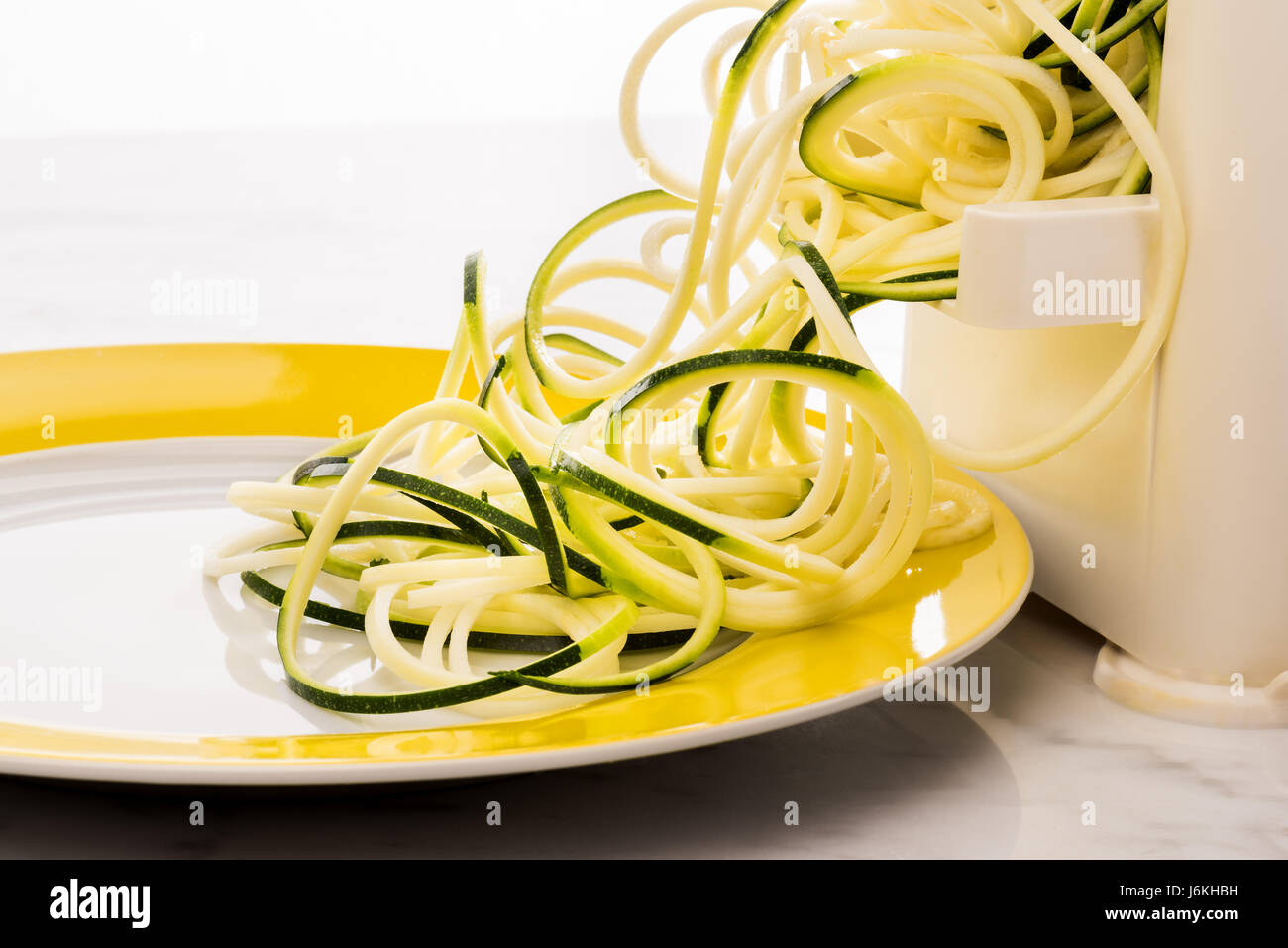 Zoodles making vegetable spaghetti zucchini pasta low carb - Stock Image
