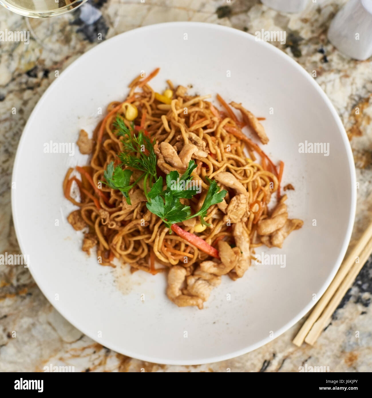 Thin noodles with chicken slices - Stock Image