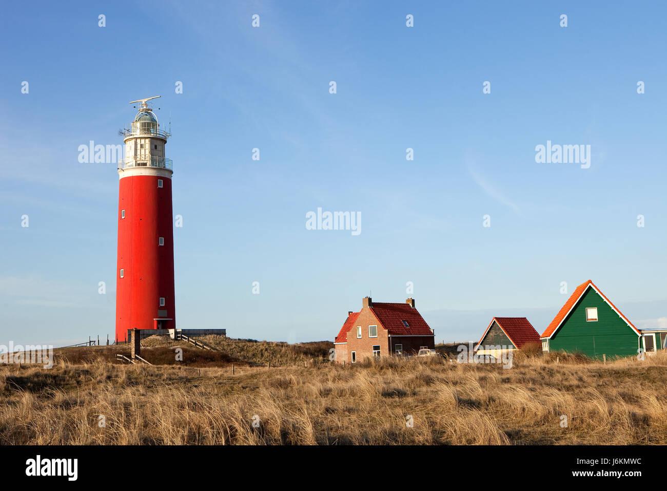 house building navy holland firmament sky lighthouse isle island blue house Stock Photo