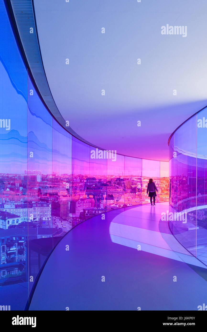 "Young woman walking through Olafur Eliassons installation ""Your raonbow panorama"" at Aarhus art museum - Stock Image"