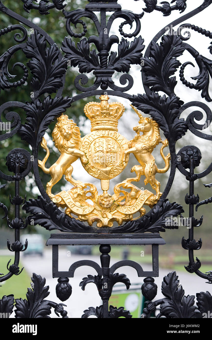 Gilded Royal coat of arms on an Ornate decorative black wrought iron ...