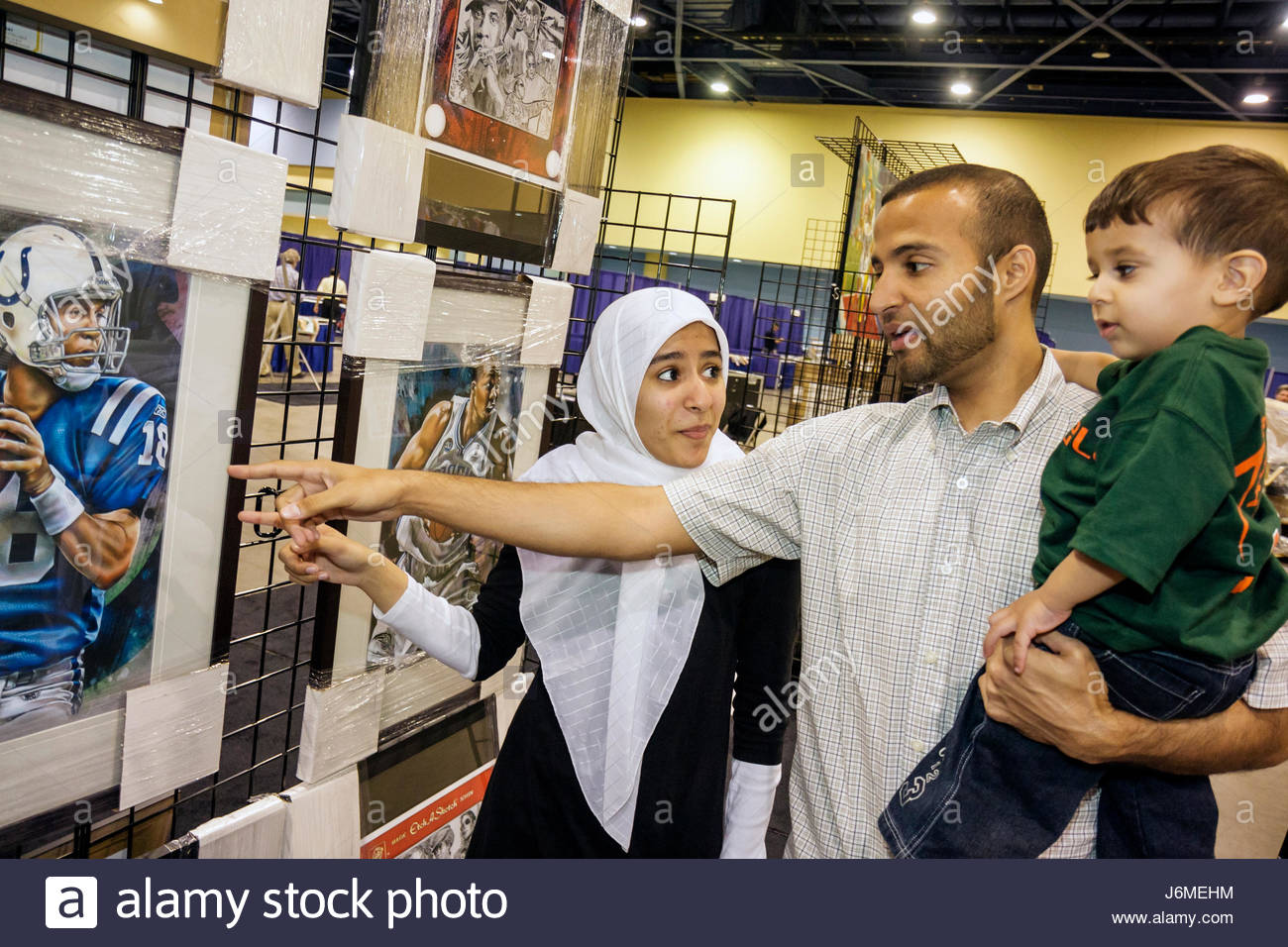 Miami Beach Miami Florida Beach Convention Center sports memorabilia collectibles for sale Mid Eastern family Muslim Stock Photo