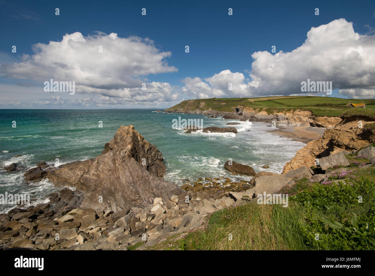 dollar cove a rocky inlet and beach on the lizard peninsula cornwall Stock Photo