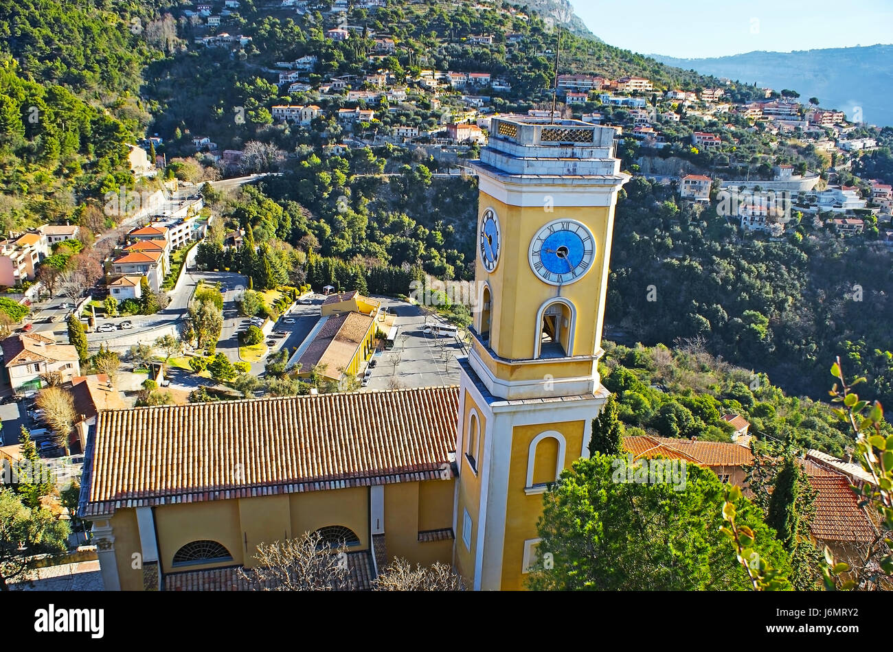 The clock tower of the Church of Our Lady of the Assumption, from the hilltop of Eze village, France. Stock Photo