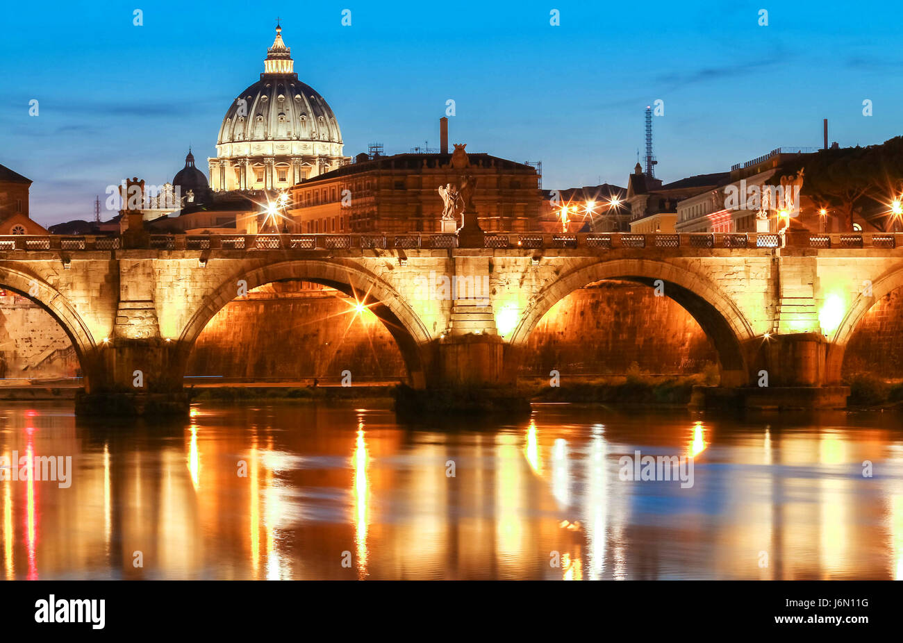 The SaintAngel bridge and St. Peter's Basilica , Rome, Italy . - Stock Image