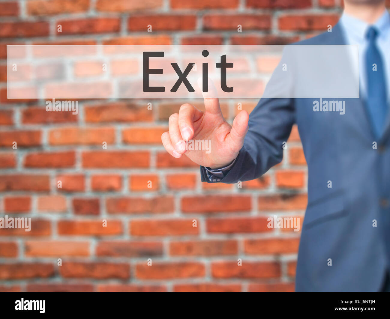 Exit - Businessman hand pressing button on touch screen interface. Business, technology, internet concept. Stock - Stock Image