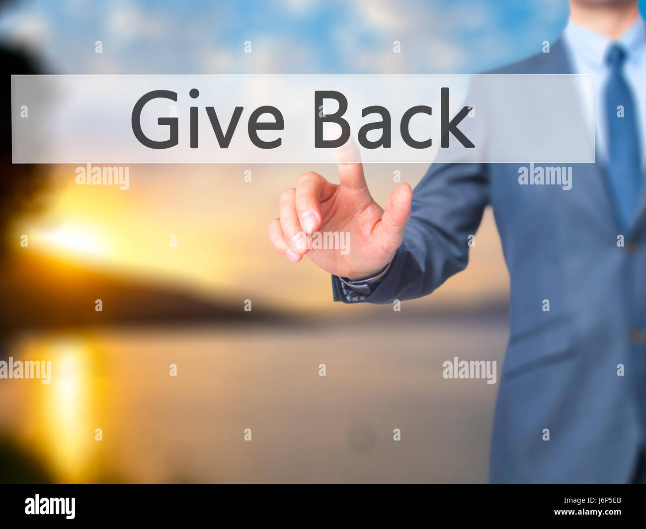 Give Back - Businessman hand pressing button on touch screen interface. Business, technology, internet concept. - Stock Image