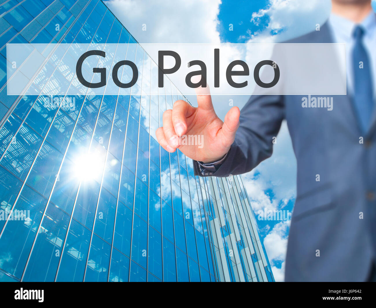 Go Paleo - Businessman hand pressing button on touch screen interface. Business, technology, internet concept. Stock - Stock Image