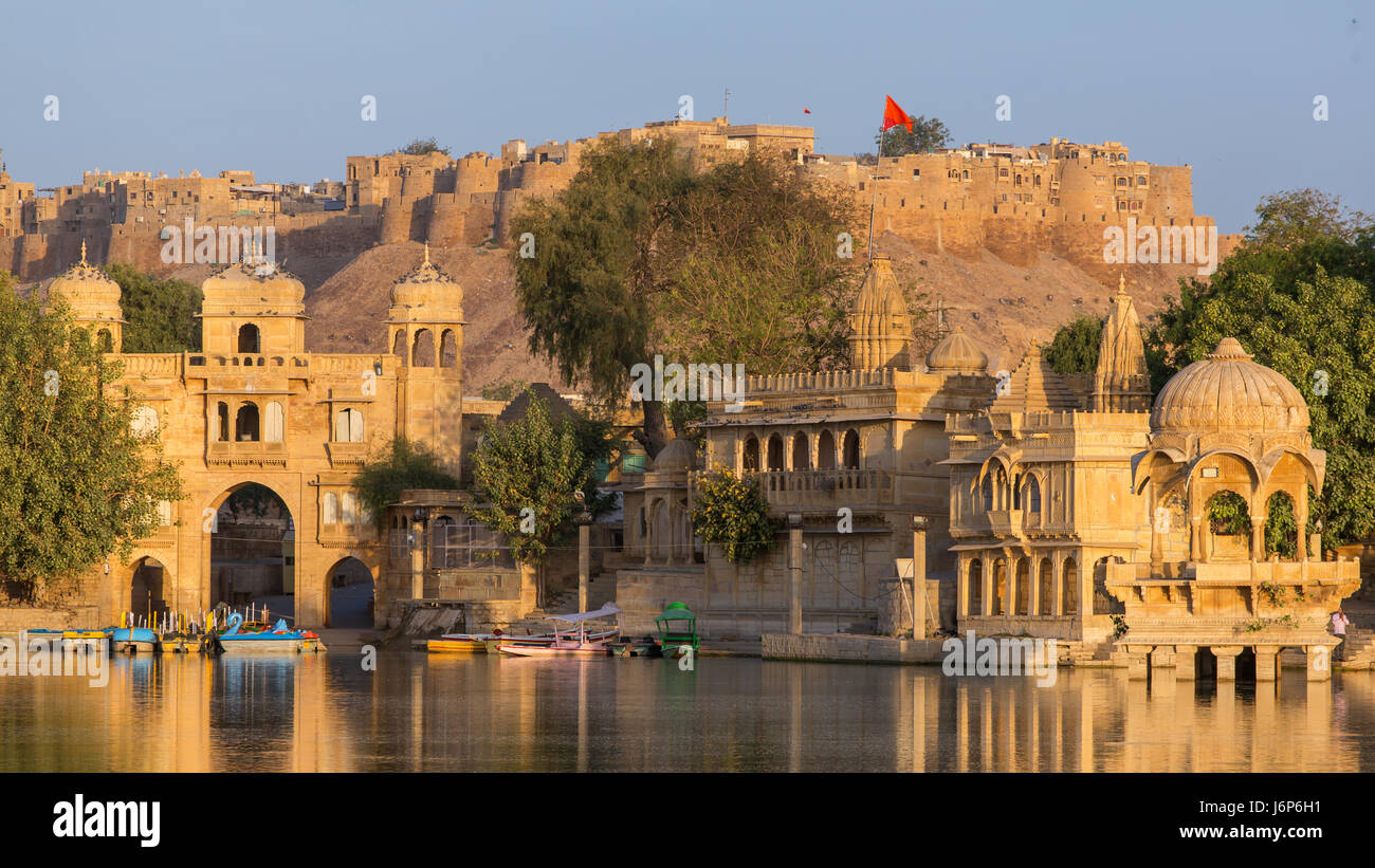 Gadi Sagar (Gadisar) Lake is one of the most important tourist attractions in Jaisalmer, Rajasthan, India. Artistically - Stock Photo
