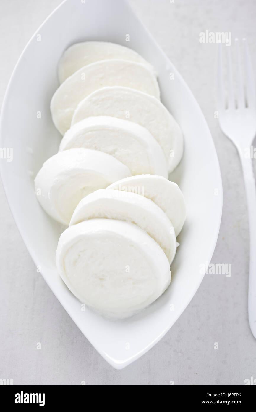 Mozzarella on white plate - Stock Image