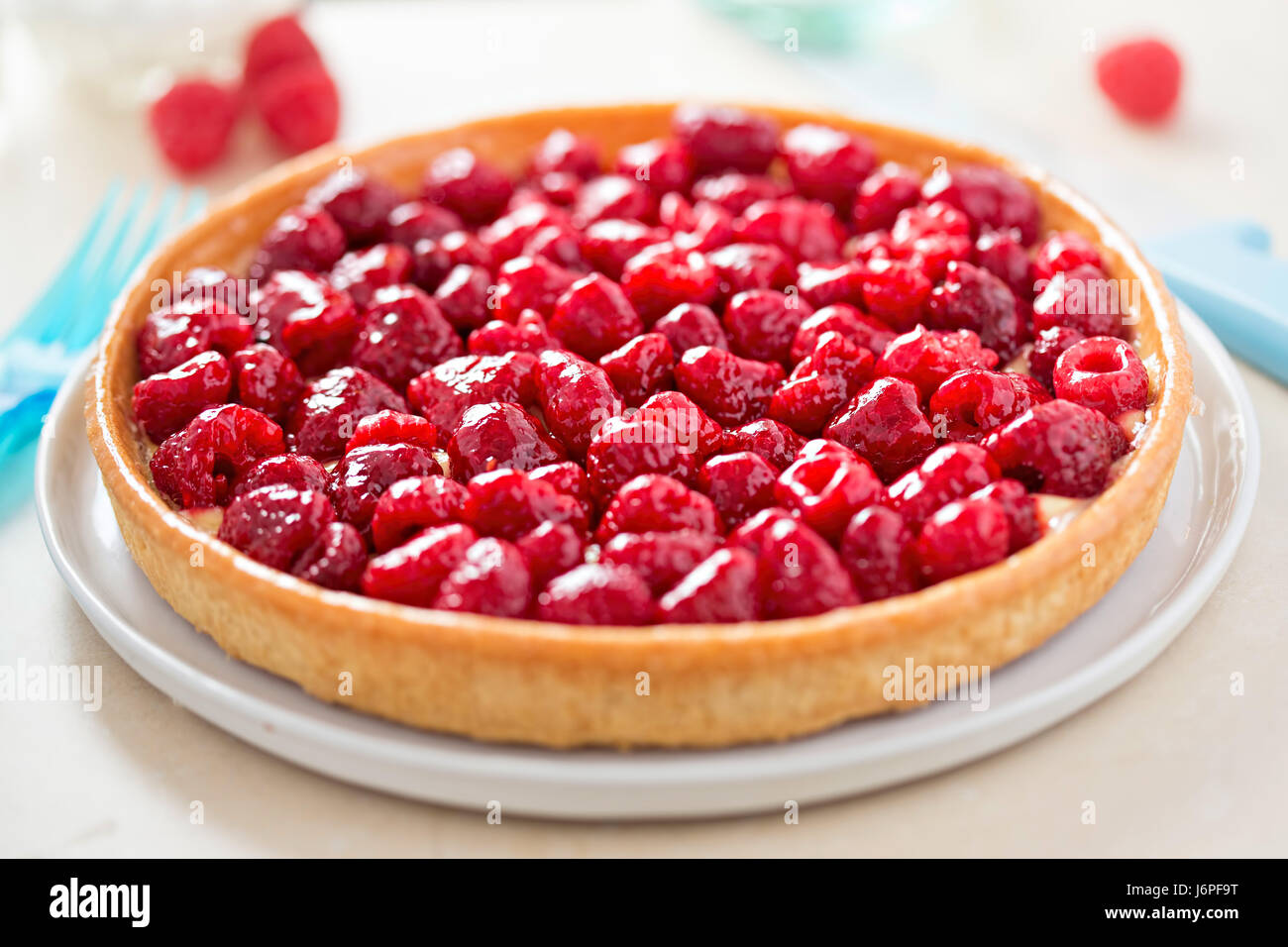 Raspberry tart with lemon filling and shortcrust pastry - Stock Image