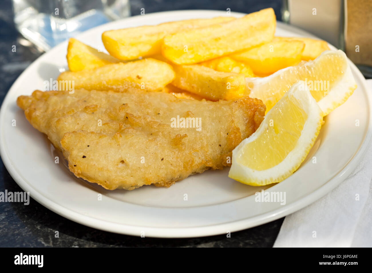 Fish and chips with lemon - Stock Image