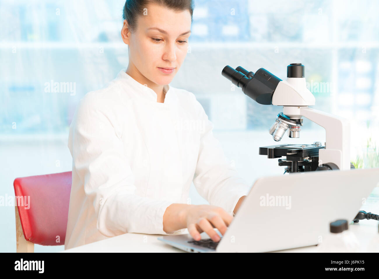 Food test in laboratory, Researcher with GMO plants. Genetically modified organism or GEO here transgenic plant - Stock Image