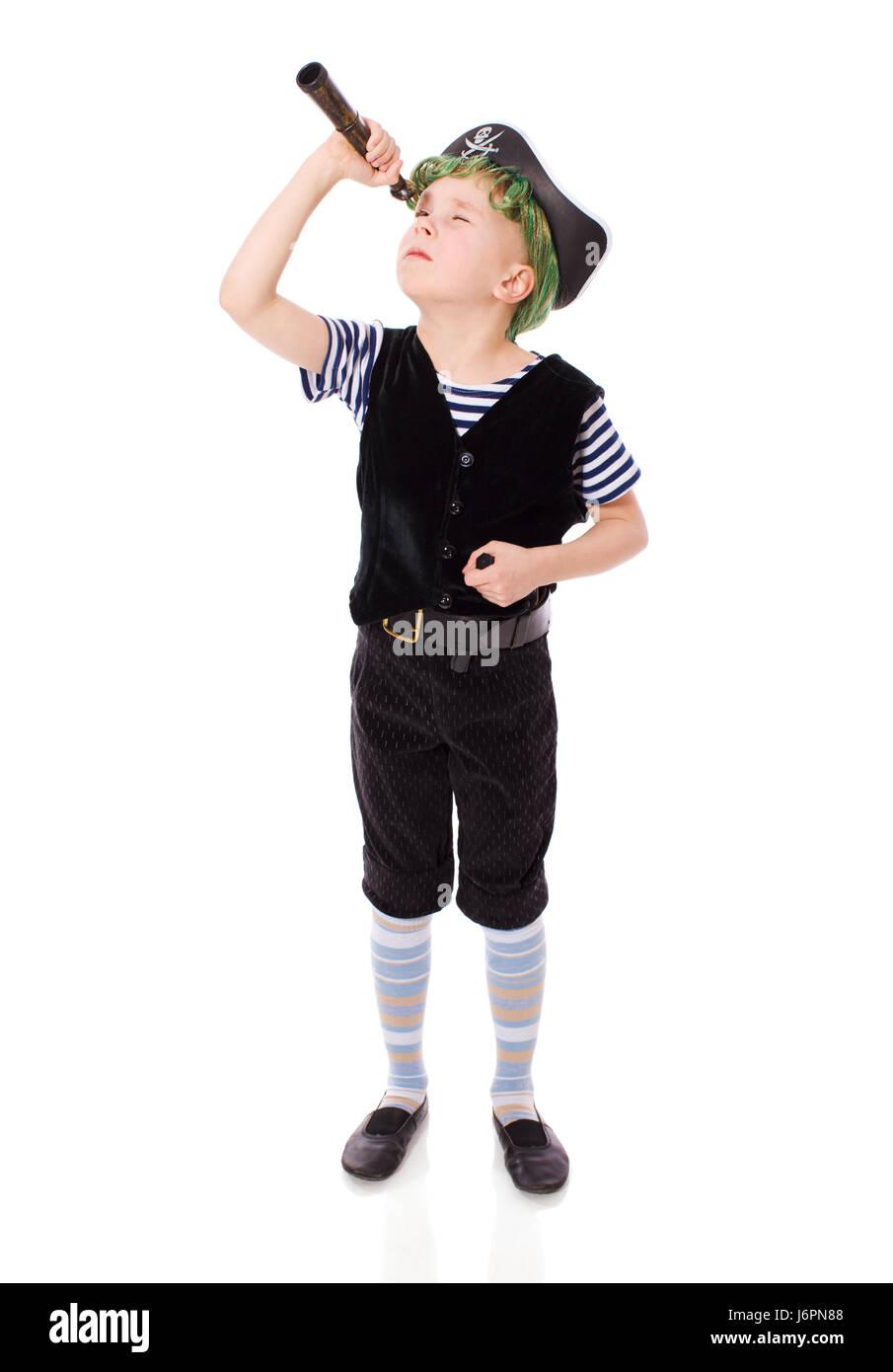 Boy wearing pirate costume holding knifes isolated on white Stock Photo