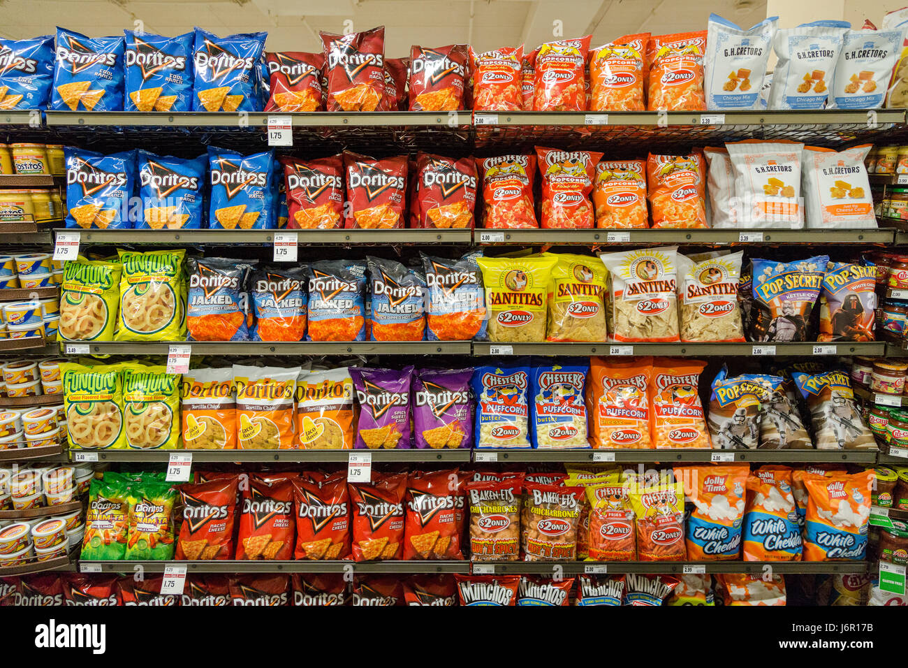 grocery store shelves with bags of junk food snacks for sale stock photo 141876767 alamy. Black Bedroom Furniture Sets. Home Design Ideas