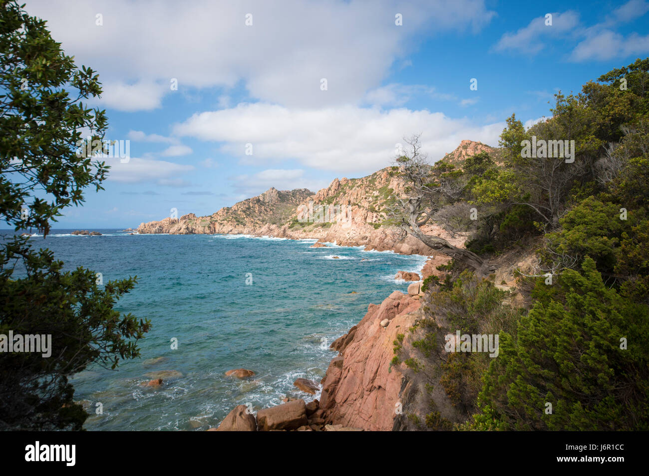 Amazing seascape of a turquoise sea in Italy. Beautiful wild beach of the Emerald coast in Sardinia. - Stock Image
