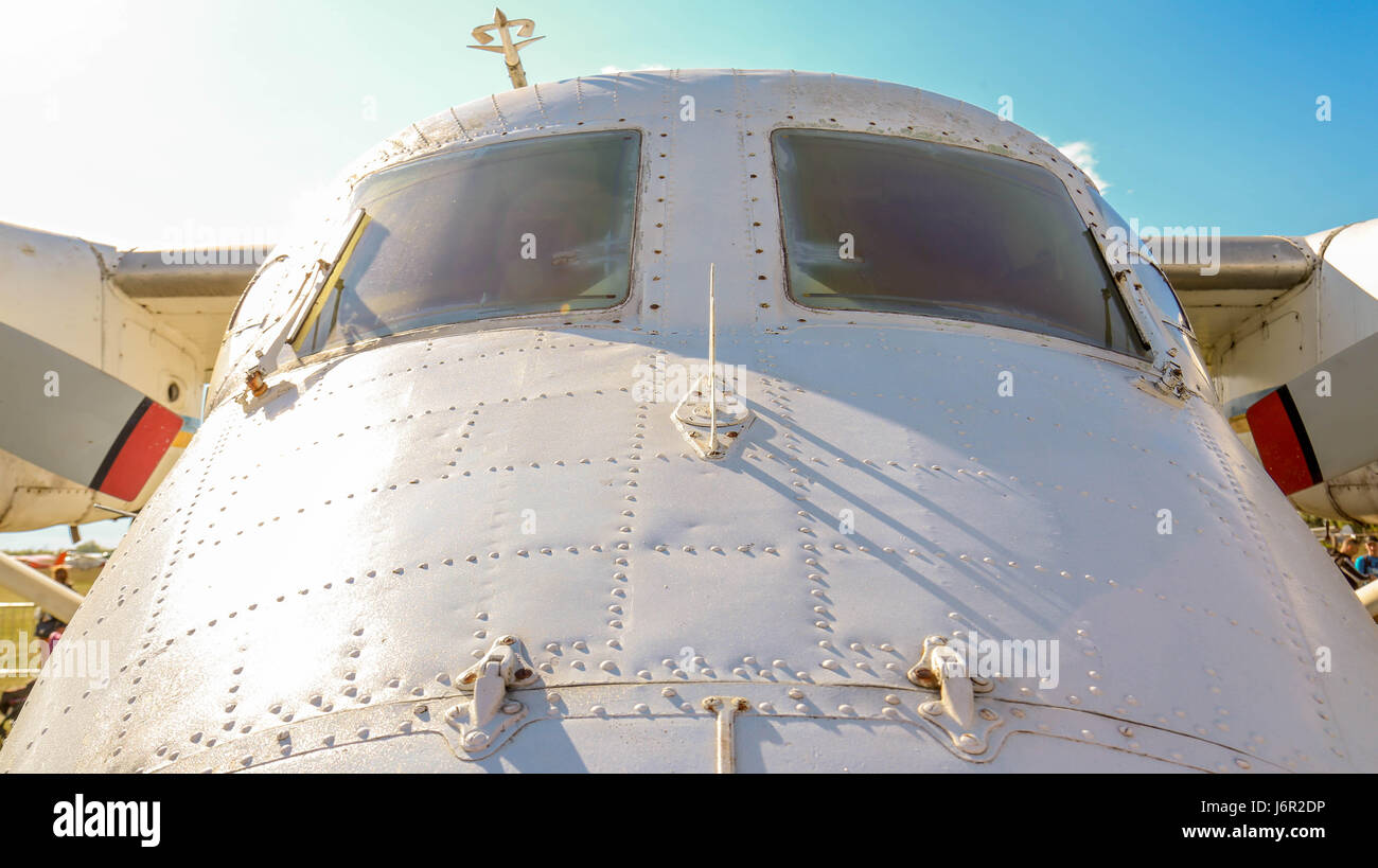 A view of an old turboprop-powered aircraft front windows. - Stock Image