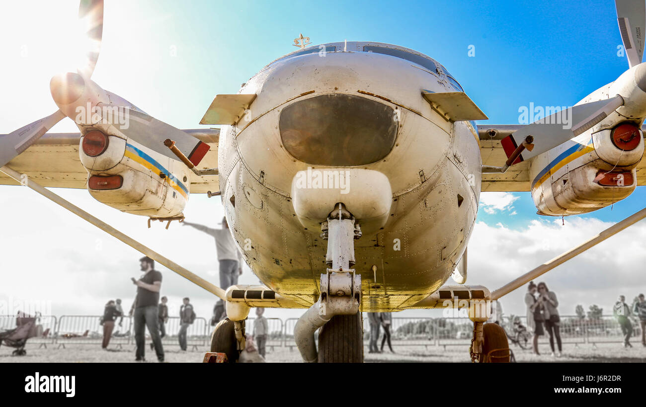 A front- and bottom-side view of an old  turboprop-powered aircraft. - Stock Image