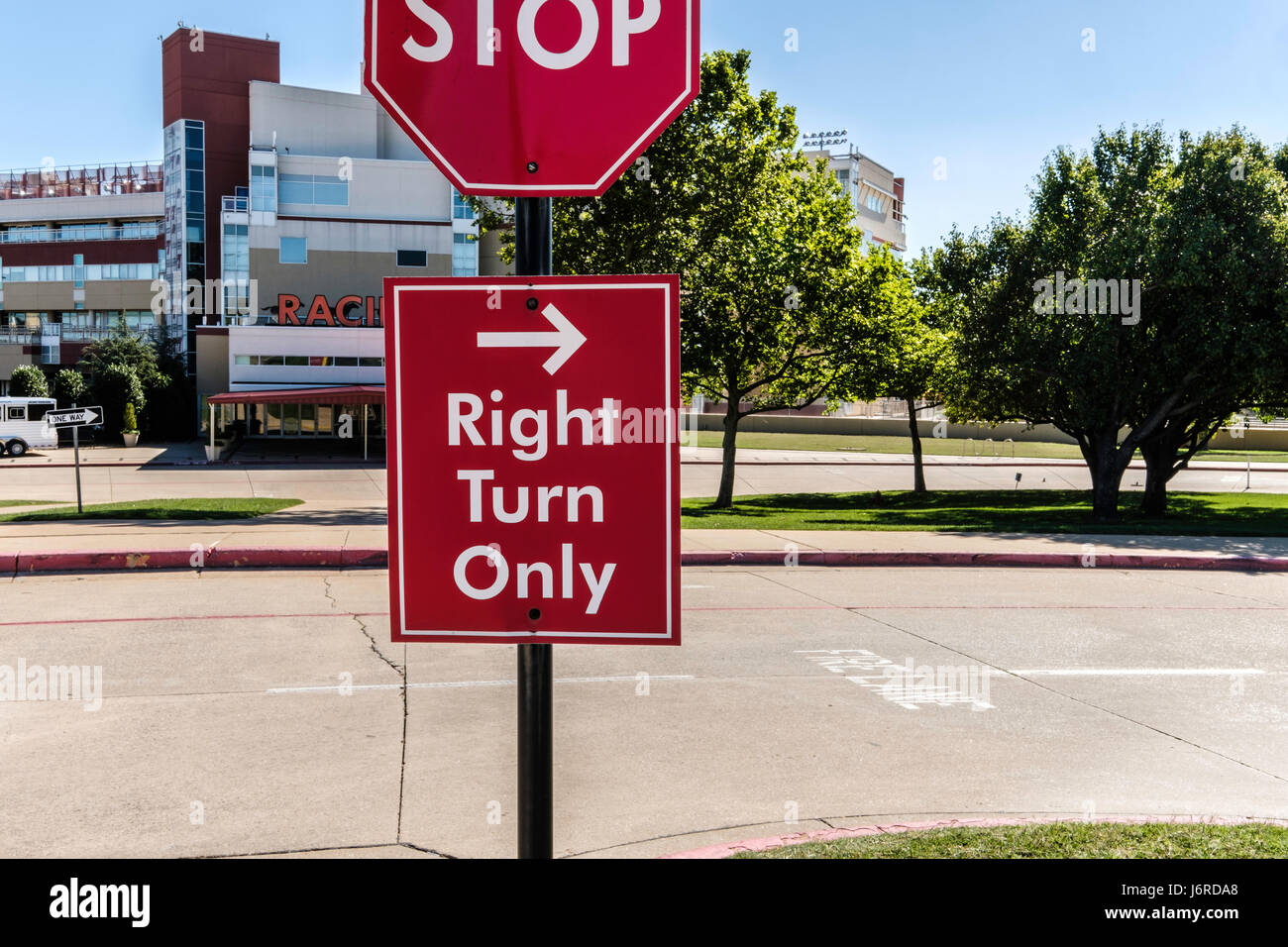 A stop sign and Right Turn Only sign in front of Remington Park, a horse racing track. Oklahoma City, Oklahoma, - Stock Image