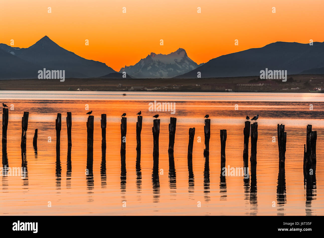 Gulf Almirante Montt,Puerto Natales, Chile - Pacific Ocean waters in Chile, Patagonia, Magallanes Region at sunset - Stock Image