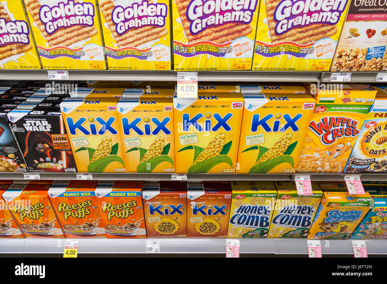 boxes of breakfast cereal on shelves at a grocery store - Stock Image