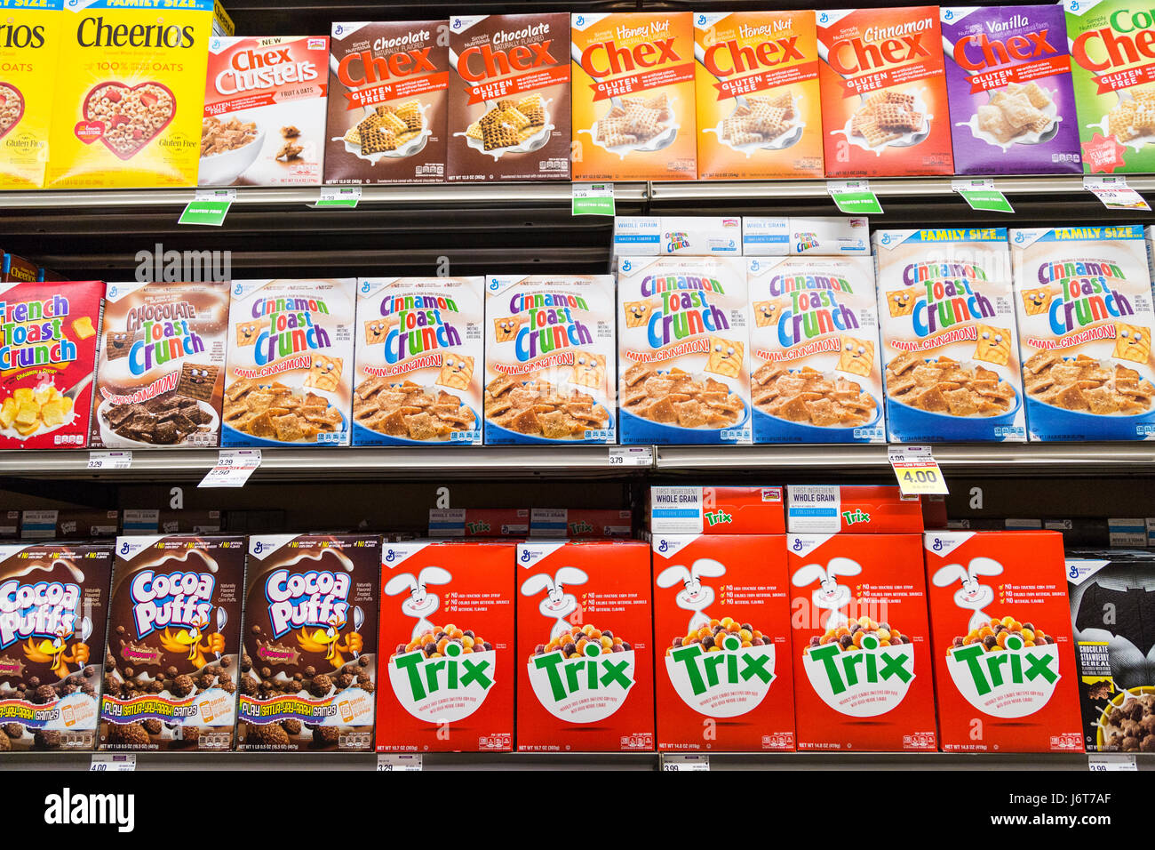 boxes breakfast cereal on shelves at a grocery store - Stock Image