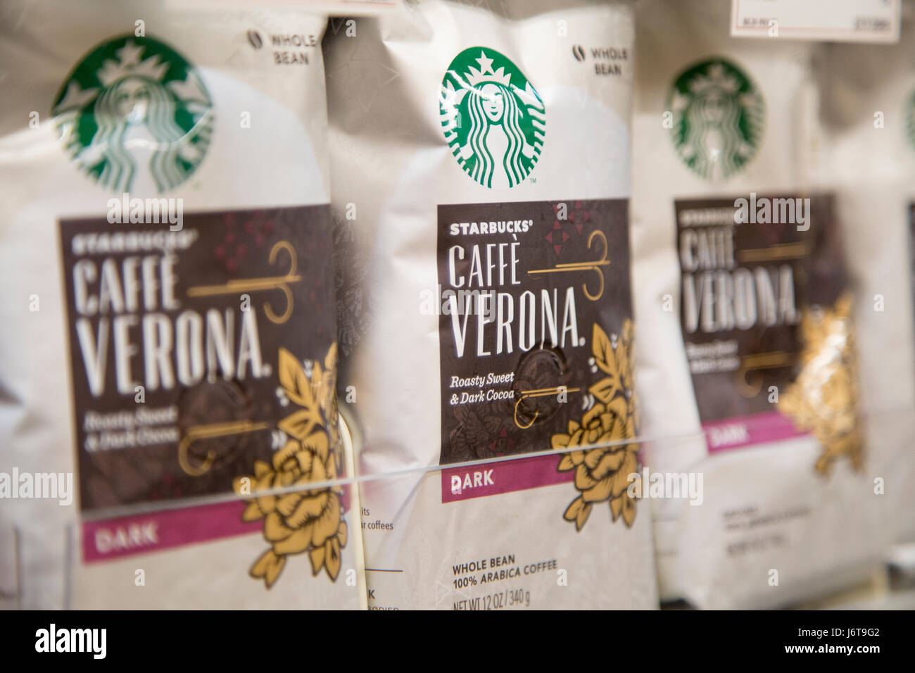 bags of Starbucks brand Caffe Verona whole bean coffee on the shelf of a grocery store - Stock Image