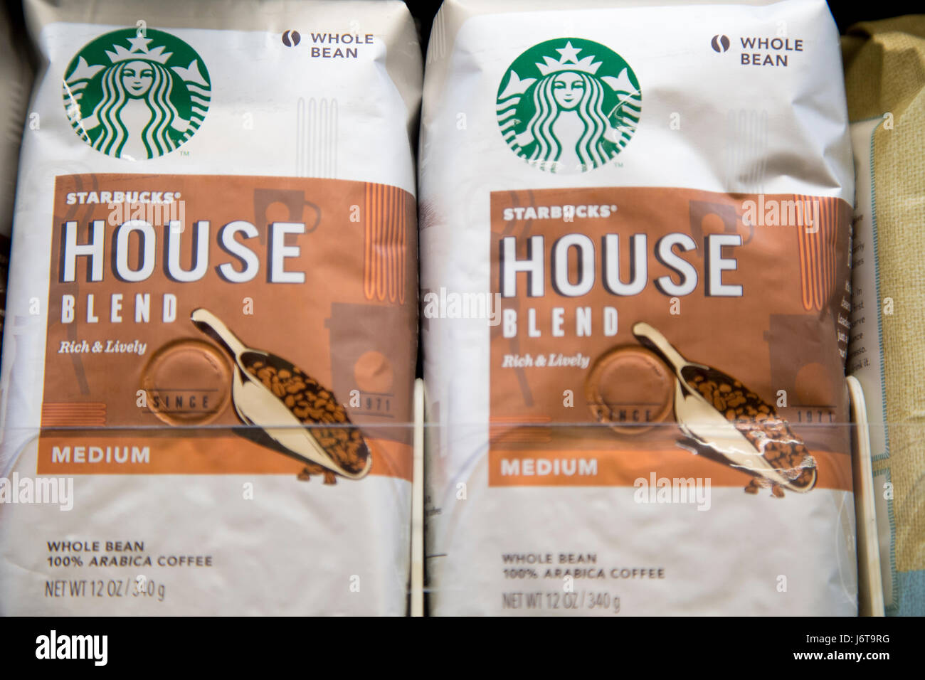 bags of Starbucks brand House Blend whole bean coffee on the shelf of a grocery store - Stock Image