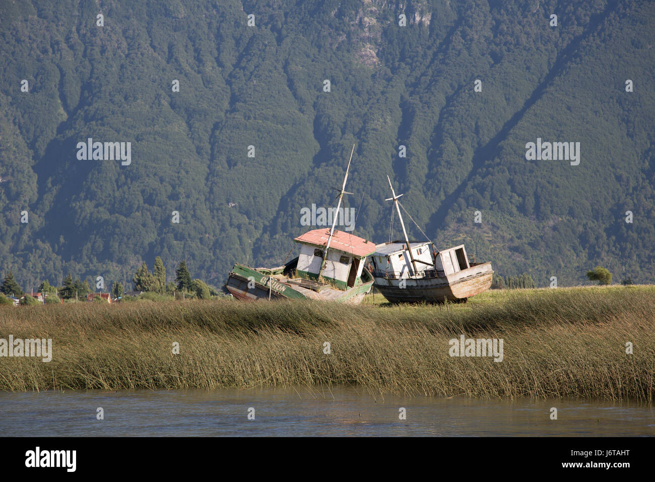 Abandoned boats in Aysen. - Stock Image