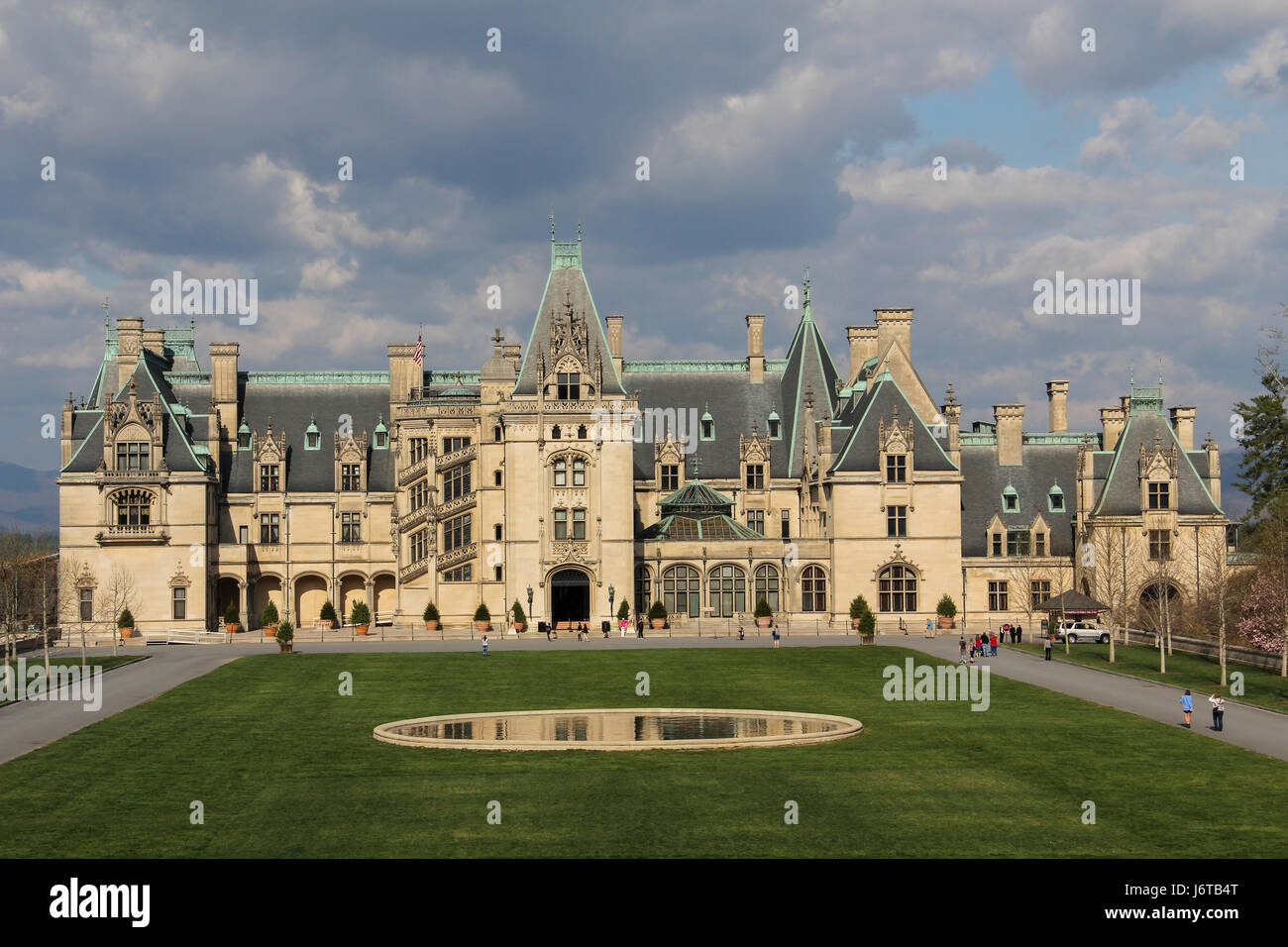 Biltmore House at the Biltmore Mansion in Asheville, North Carolina.  Sun on the house and clouds in the sky. - Stock Image