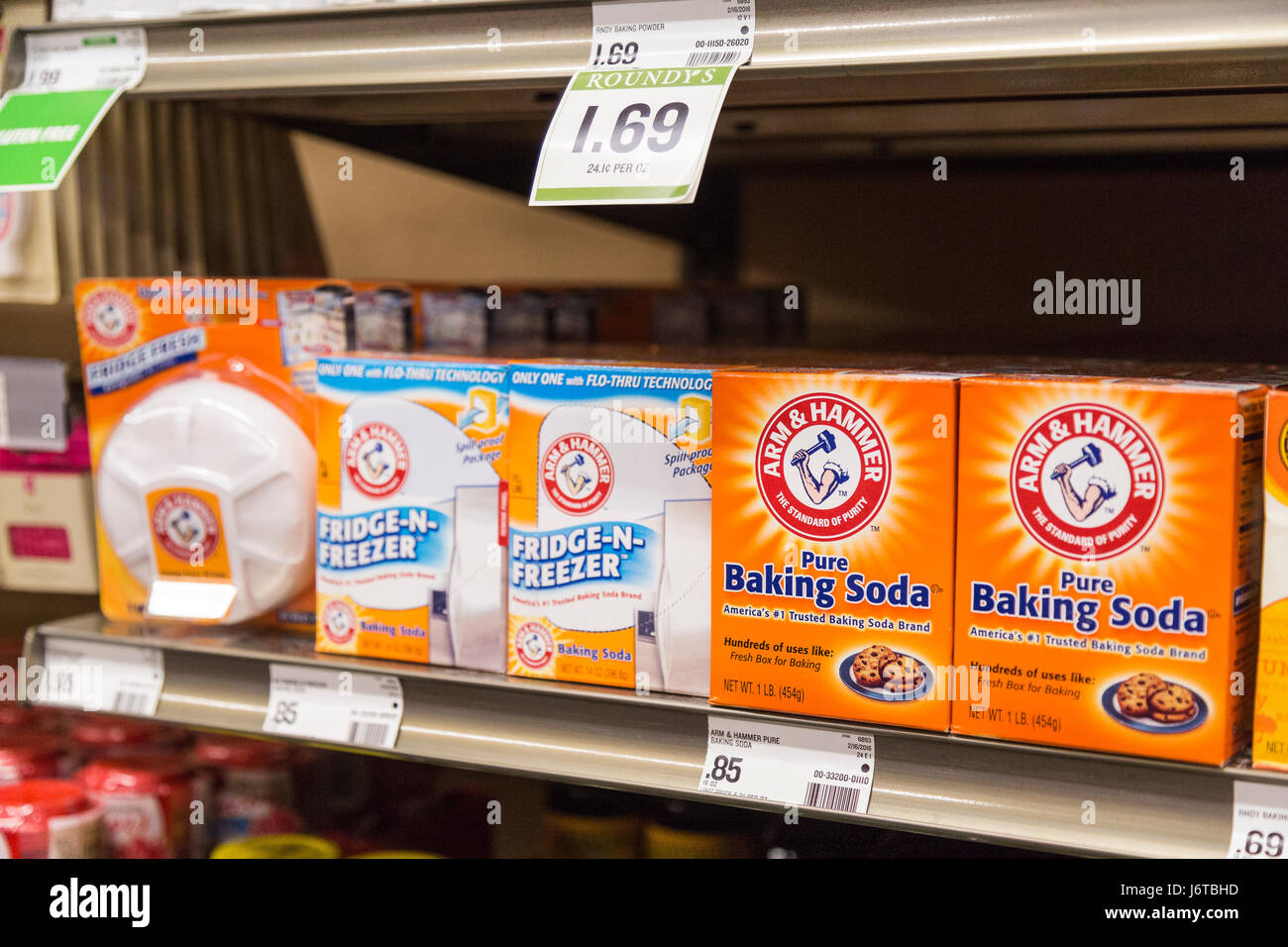 packages of Huggies brand diapers on a shelf of a grocery store - Stock Image