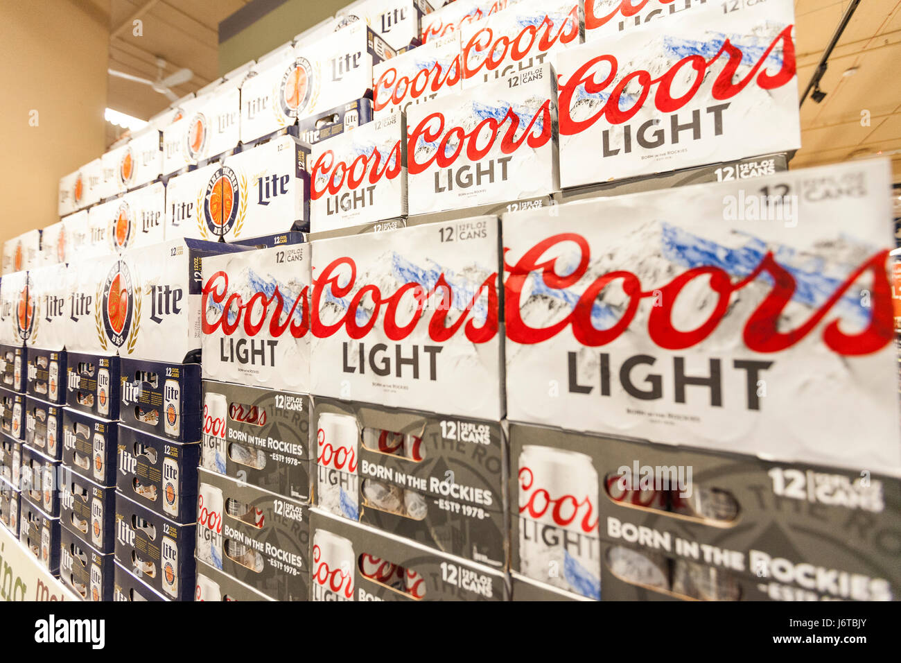Cases of Coors Light and Miller Lite beer on display and for sale in a grocery store - Stock Image
