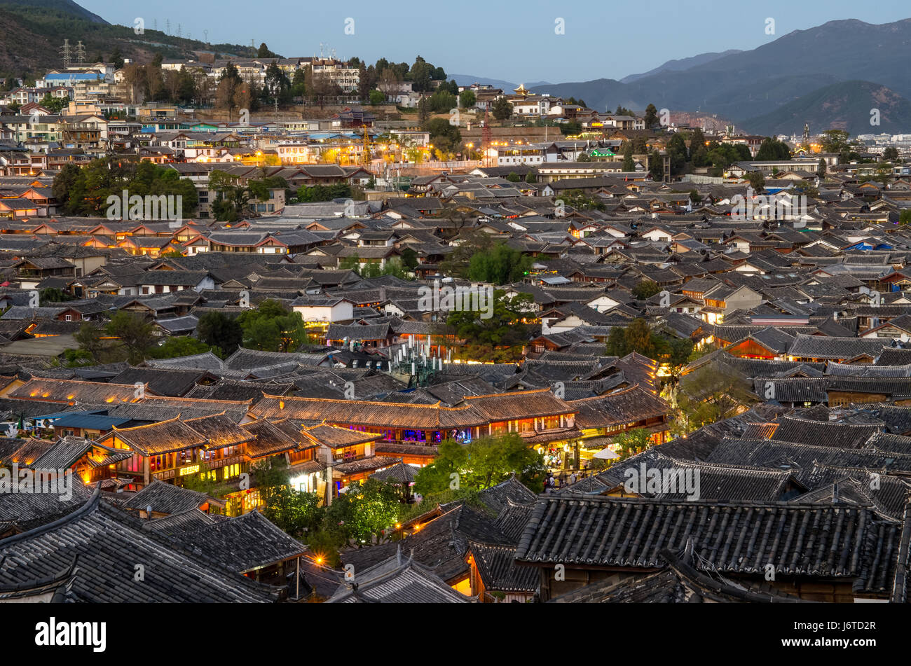 Lijiang, China - April 10,2017 : Evening bird eye view of local historical architecture roof building of Old Town - Stock Image