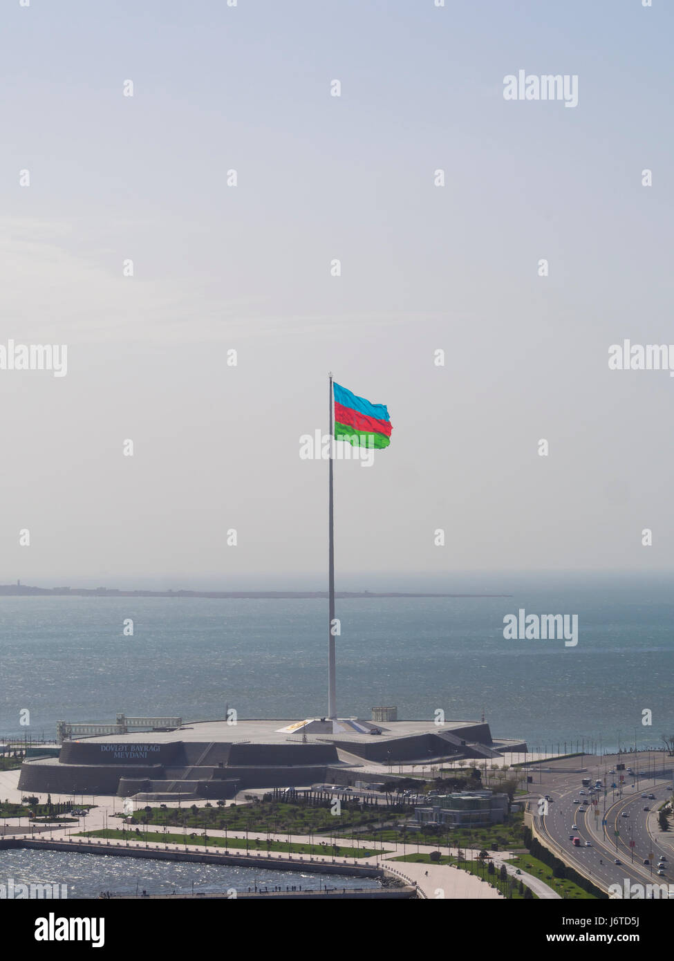 Baku, the capital city of Azerbaijan, on the shore of the Caspian sea, view of the giant flagpole and flag in Bayraq - Stock Image
