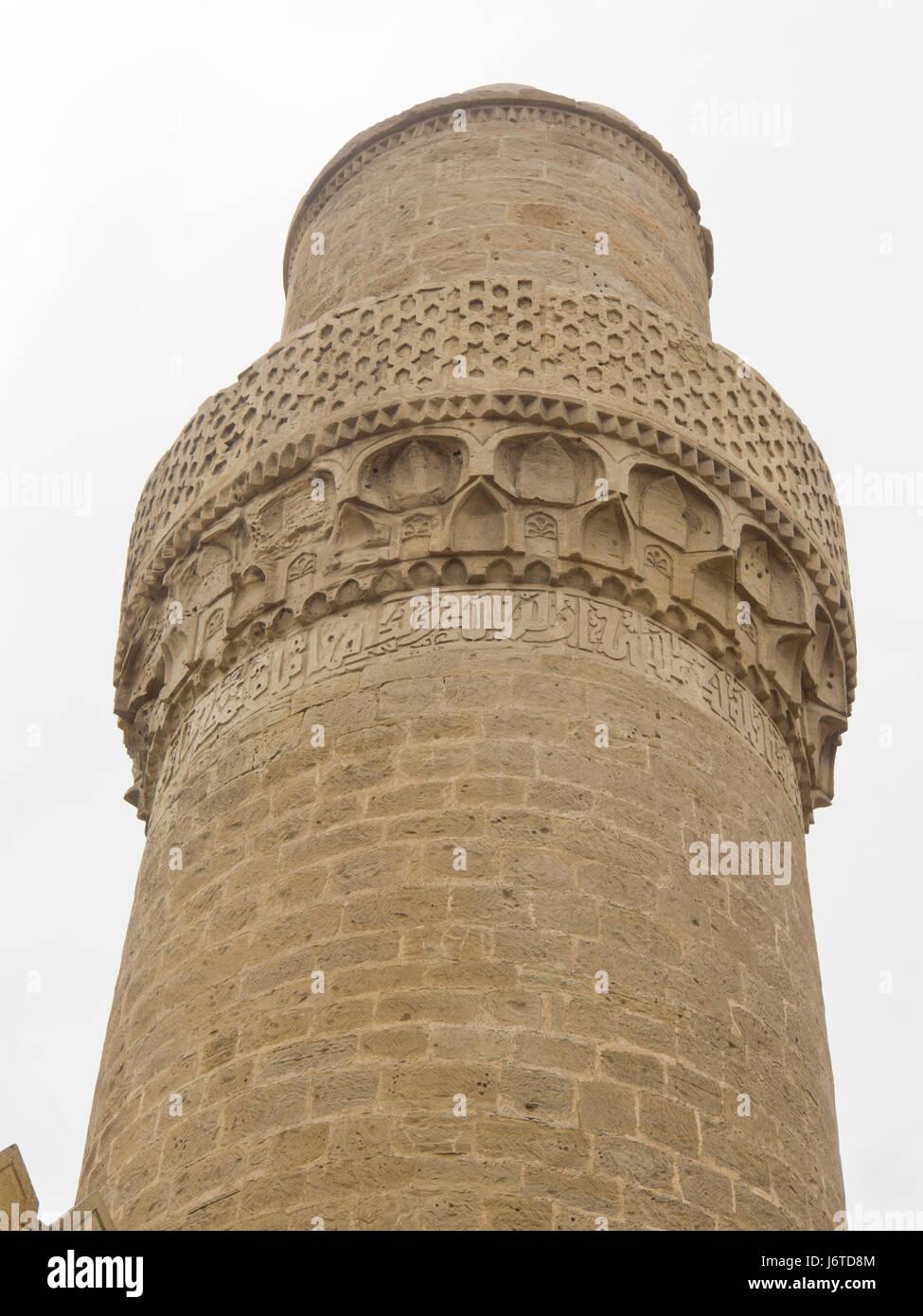 Minaret of Juma Mosque in Baku old town, Icheri sheer a Unesco World heritage site  in Azerbaijan - Stock Image