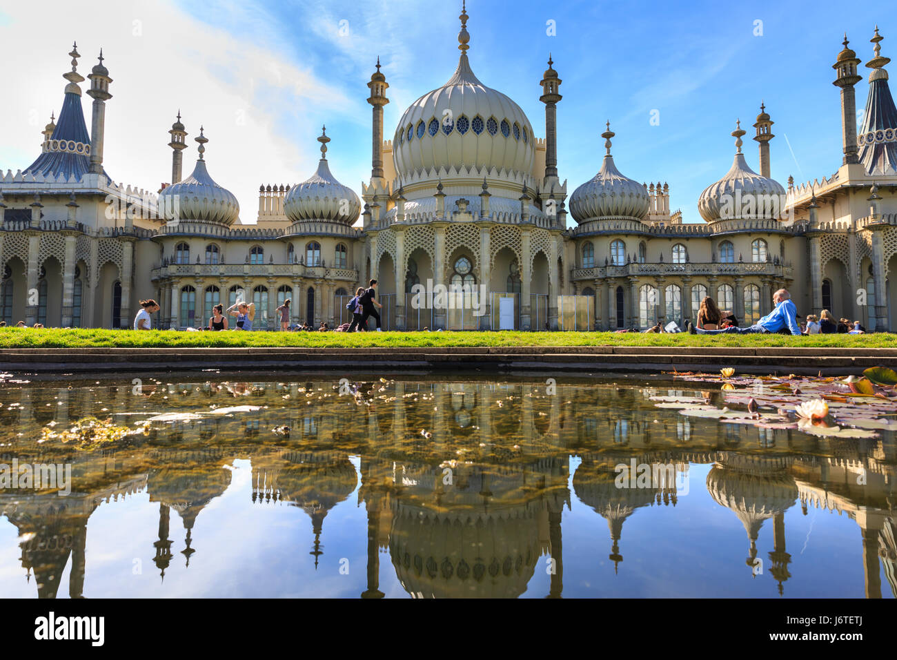 Brighton, UK, 21st May 2017. People enjoy a sunny and warm day on the lawns around Brighton's Royal Pavilion - Stock Image