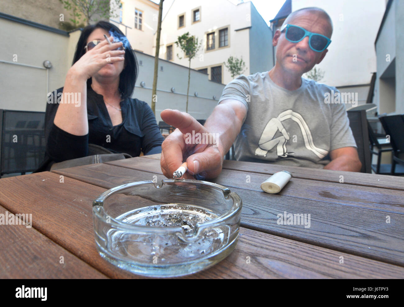Pilsen, Czech Republic. 19th May, 2017. Woman and man smoke the cigarettes at the pub Beer Factory in Plzen, Czech - Stock Image