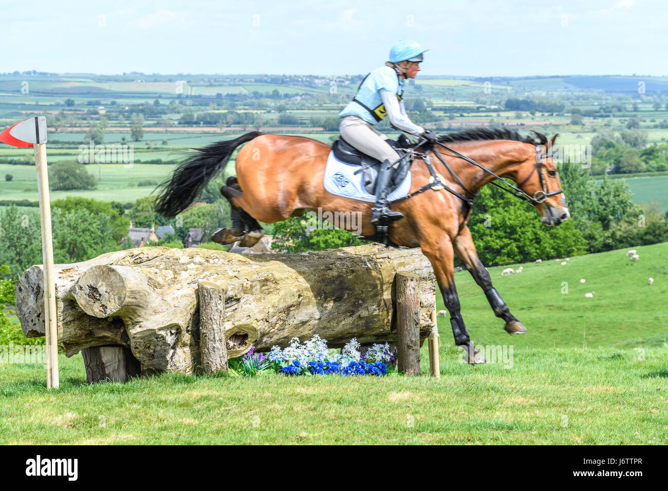 Rockingham Castle, Corby, UK. 21st May, 2017. Izzy Taylor and her horse Perfect Stranger clear a log obstacle with Stock Photo
