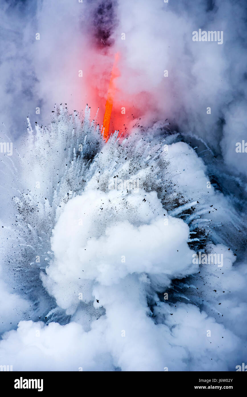 A lava flow on the big Island of Hawaii known as the fire hose spews out molten magma from Kilauea Volcano into - Stock Image
