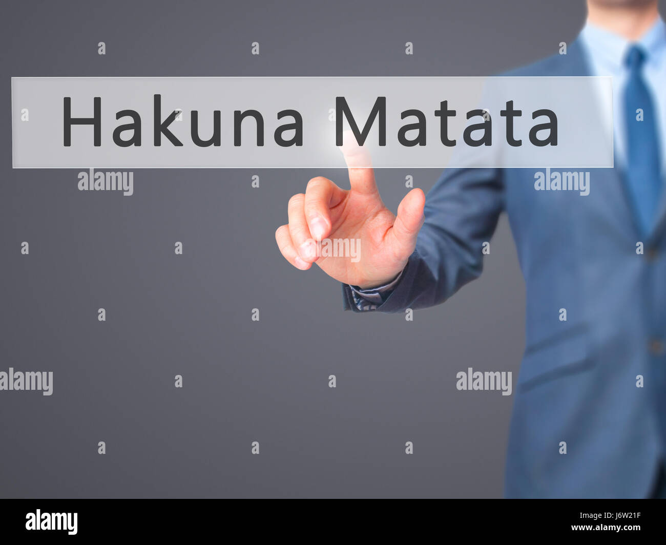 Hakuna Matata (Swahili phrase it means no worries)  - Businessman hand pressing button on touch screen interface. - Stock Image