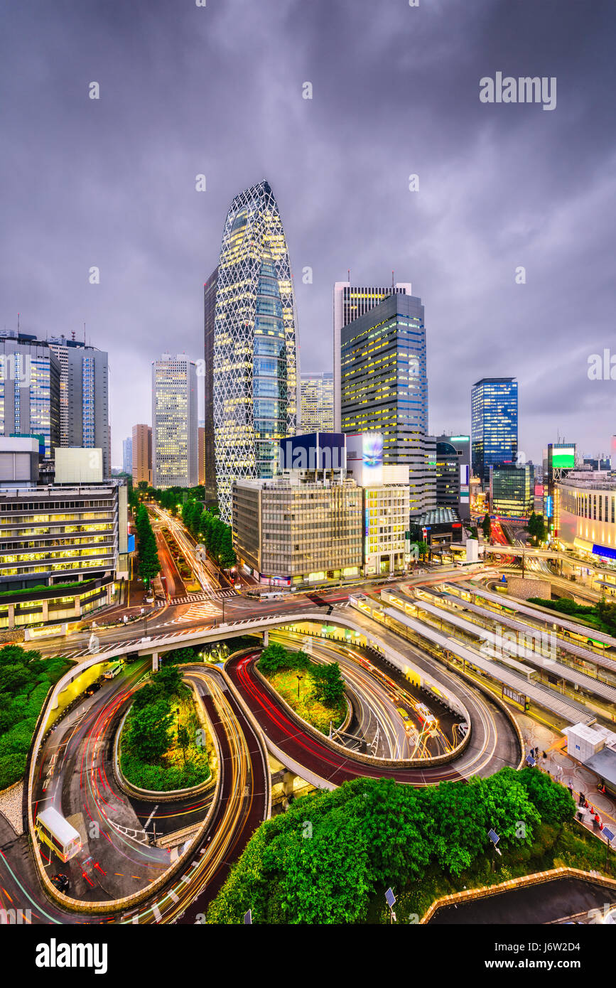 Nishi-Shinjuku, Tokyo, Japan financial district cityscape. (Text on road reads: 'Bust Stop.') - Stock Image