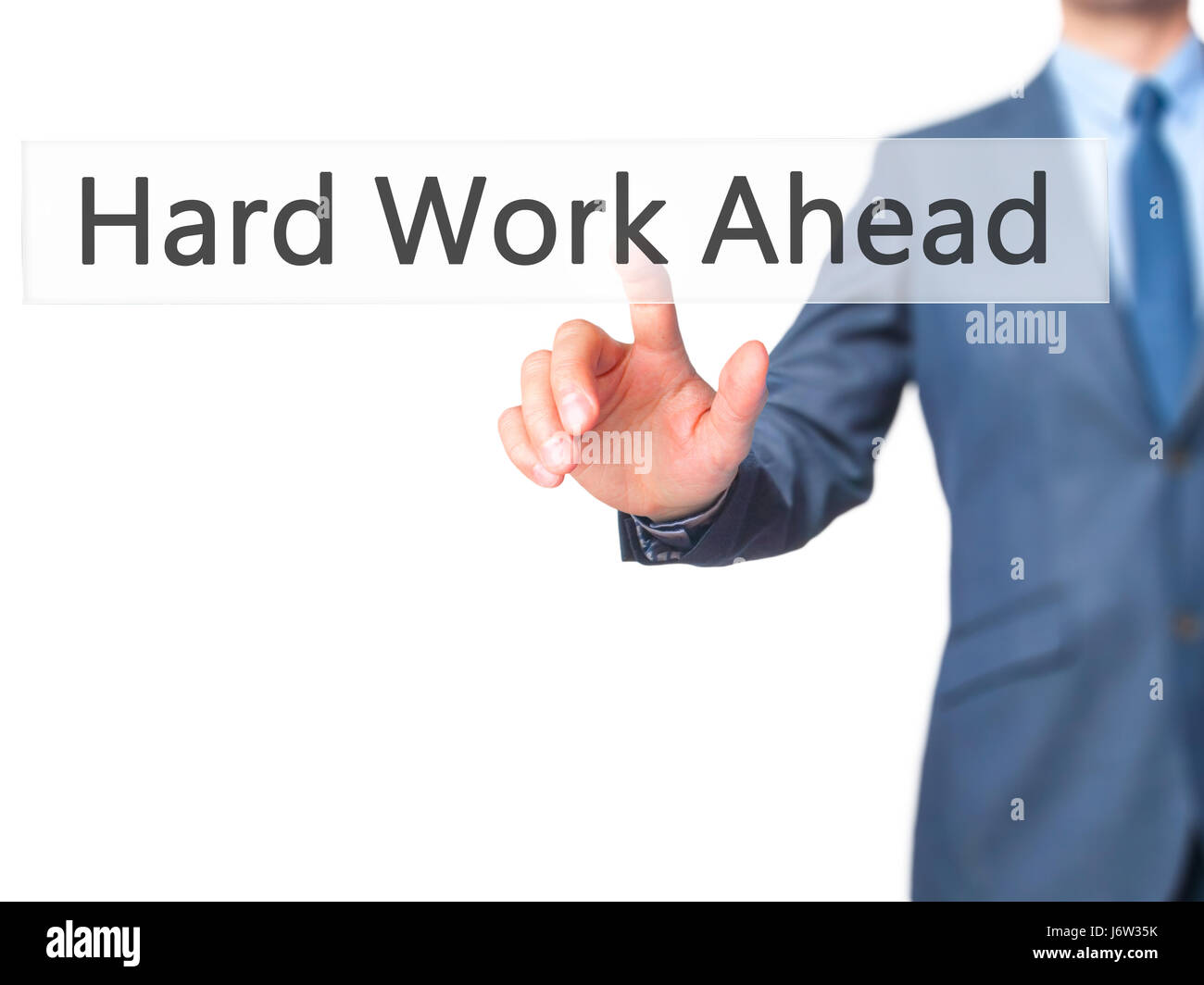 Hard Work Ahead - Businessman hand pressing button on touch screen interface. Business, technology, internet concept. - Stock Image