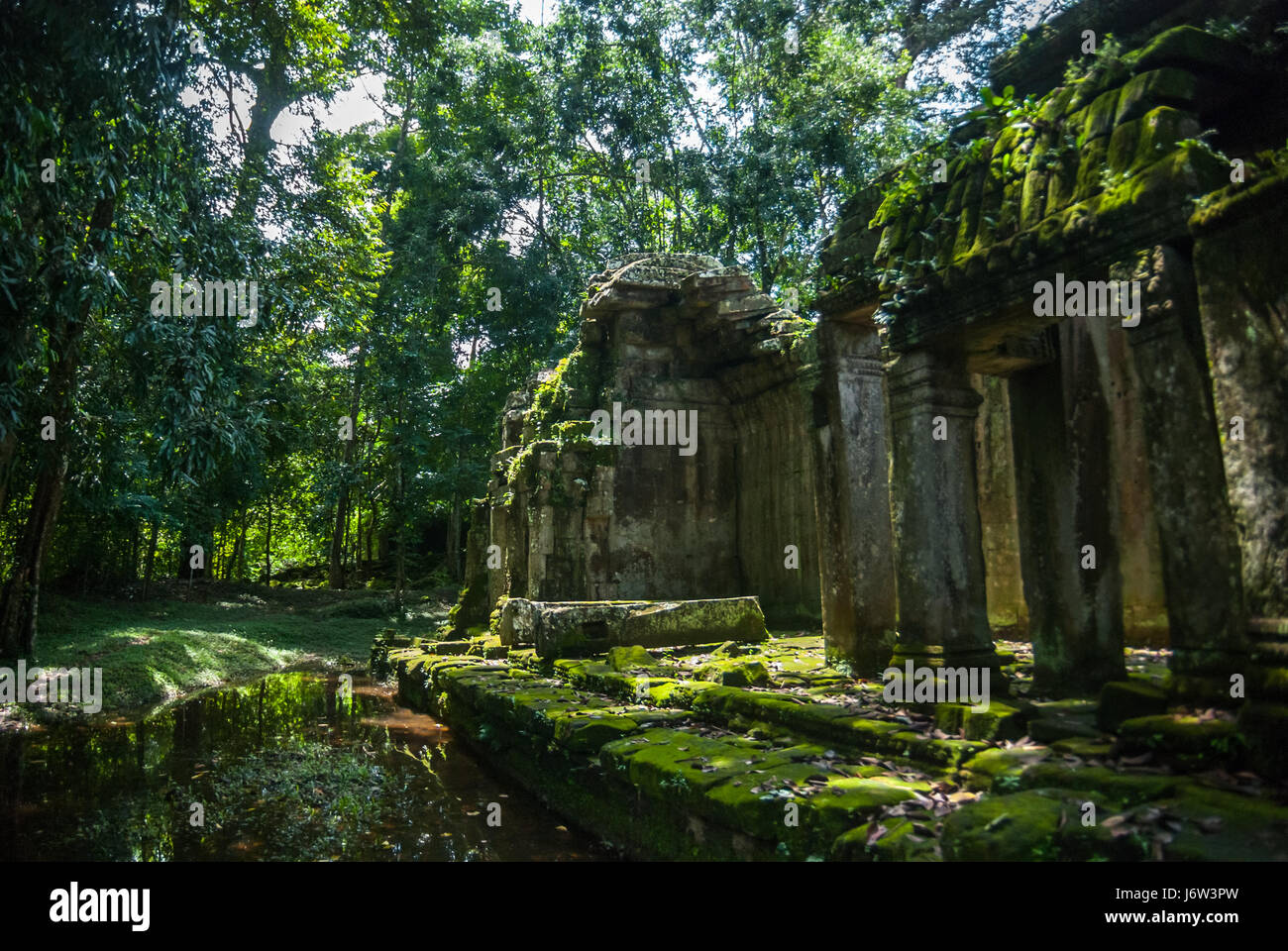 Ancient architecture of Ta Prohm temple with canal in Angkor complex, Siem Reap, Cambodia. - Stock Image