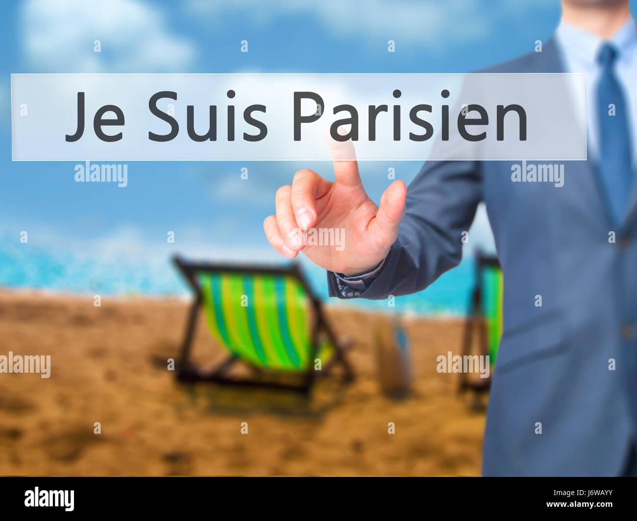 Je Suis Parisien ( I am Parisien)  - Businessman hand pressing button on touch screen interface. Business, technology, Stock Photo